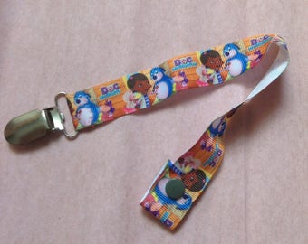 Girl or boy with new grosgrain Ribbon pacifier clip