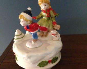 1038 Ceramic Children Playing in Snow