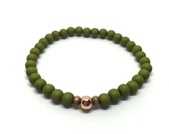 Bracelet in olive green with brass beading