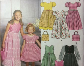 Simplicity 9497-Six variations of dresses-Size HH 3,4,5,6