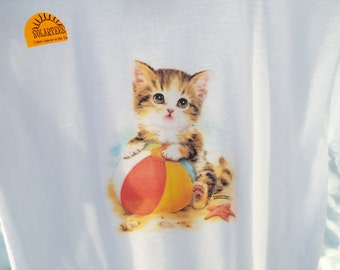 cat with beach ball changes color in sunlight