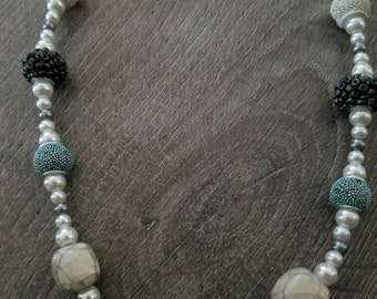 Beaded necklace with pearl, blue and gray beads, and toggle clasp