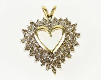 10k Diamond Encrusted Starburst Cluster Heart Pendant Gold