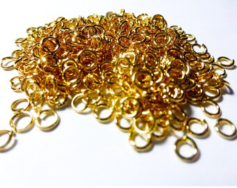 110 jump rings 4mm gold tone (ref SFAD01)