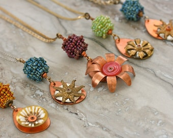 Nature inspired necklaces featuring vintage components and hand beaded beads. Floral, garden, nature.