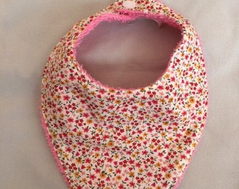 Pink bandana bib with floral cotton fabric lined with Terry cloth