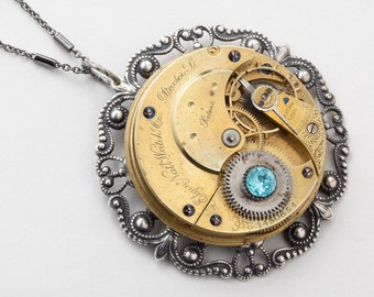 Steampunk Necklace Vintage Elgin gold pocket watch movement silver filigree bezel and blue crystal pendant necklace by Steampunk Nation