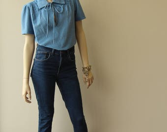 Light blue blouse with short sleeves