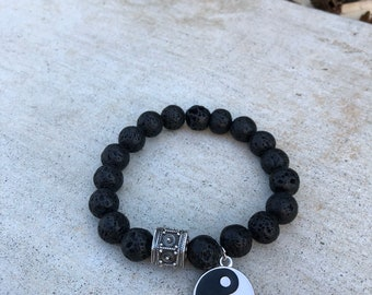 Lava Beads with Silver Bali bead and Charm. Comes with a vial of essential oils.