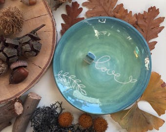 Ceramic saucer with home-love
