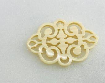 Acrylic Oval Scroll Piece 55x40mm in Ivory