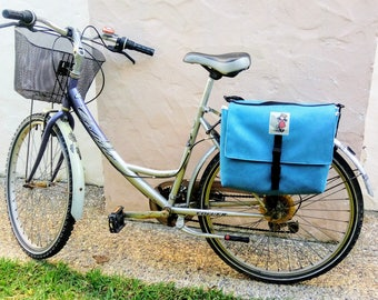 Double pannier. Blue saddlebags for bicycle, convertible in shoulder bag. Bike panniers.