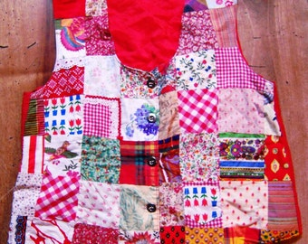 Jacket in patchwork to predominantly red. (size 40/42)