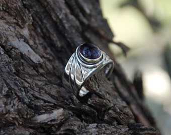 Modern type wearing an amethyst sterling silver ring