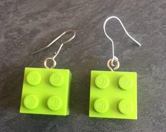 pair of light green lego earrings