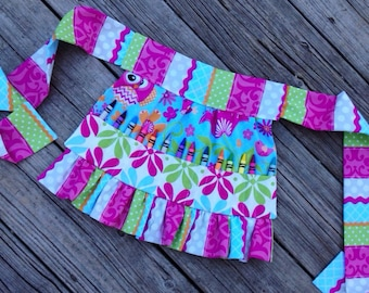 Crayon Apron - comes filled with 14 crayons and is avaliable in over 100 fabrics