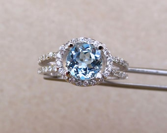 Brilliant Genuine  Sky Blue Topaz in a Glowing Accented Sterling Silver Setting