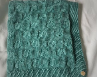 Hand knitted cashmere blend spotty baby blanket