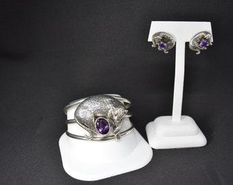Carol Felley leapard cuff bracelet and earrings.