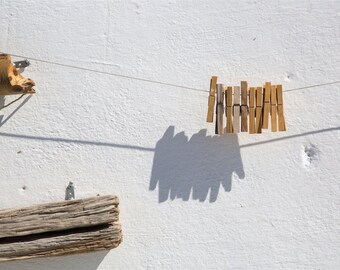 Greek Islands Photography - Minimalism, Simplicity - Clothespins in Oia, Santorini