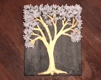 gold, white,and black tree painting