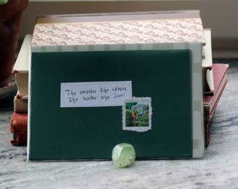 The smaller the cabin, the wider the door (Irish proverb) - Dark green card with handwritten quote and Swedish allotment garden postal stamp