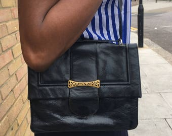 Leather Bag with art deco' style closure