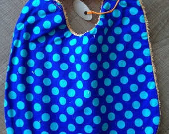 Orange Terry lined blue polka dot bib