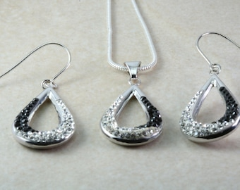 Silver dropper ear rings and Pendant.Set with Black and White Cubic Zirconia's. Christmas,Birthday,Anniversary Present.