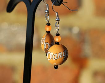 Recycled vintage US small orange bottle cap earrings. Dang that's good!  Retro root beer bottle caps made into rounded beads.