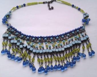 blue and green plastic bead tassel bib necklace
