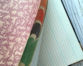 Antique unused ledger, blue and red square ruled pages, beautiful decorative end papers and marbled page edges. Art journal or sketch book.