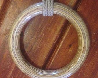 Varnished timber shibari ring