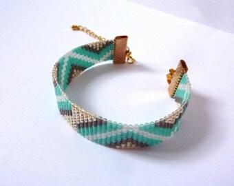 Asymmetric turquoise woven bracelet