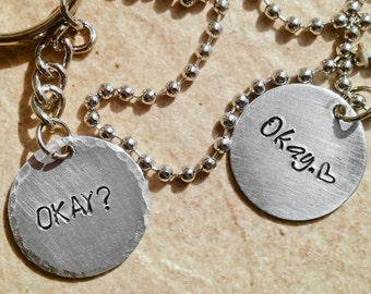 """The Fault in Our Stars Inspired """"Okay"""" Stamped Metal Necklace His and Hers Couples Set of 2 Necklace Key Chain"""