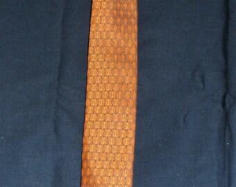 VINTAGE SKINNY TIE / Iridescent Pumpkin Colored Embossed Geometric Stacked Diamond Pattern/One Hundred Percent Trevira/1960s Vintage Necktie