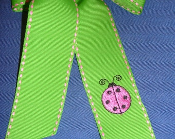 Hairbow with pink lady bug