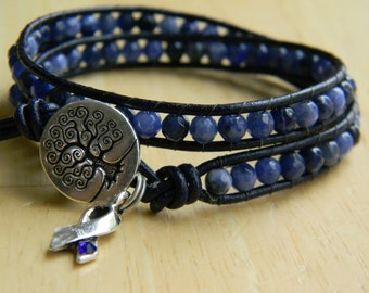 Dark blue ribbon; colon cancer awareness and support faceted gemstone & leather wrap bracelet; gift for colon cancer survivor; cancer gifts