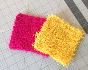 Crochet dish scrubbies in hot pink and yellow