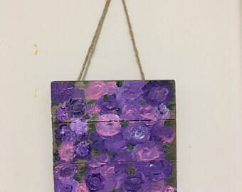 Hanging purple flowers on wood