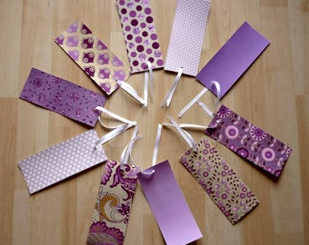 Large tags in mauve and purple color for wish tree