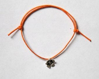 Silver flower charm on waxed cotton cord adjustable friendship bracelet