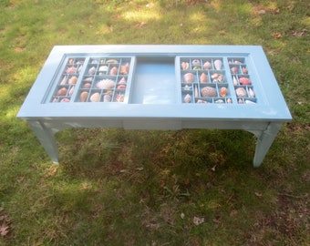 Coffee table, painted maple wood with a shell collection and drawer for adding your own collection.