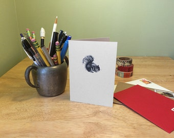 Squirrel notecard.  Squirrel drawing on a note card with natural history facts about squirrels on the back.