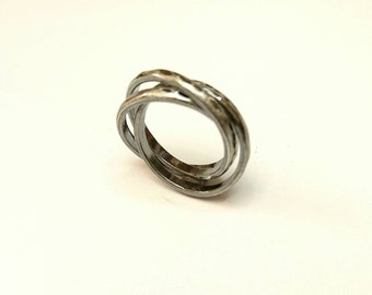 Sterling silver Russian style wedding rings, oxidised and textured. Hallmarked in Edinburgh