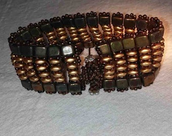 Brown and gold beaded cuff with handmade toggle clasp