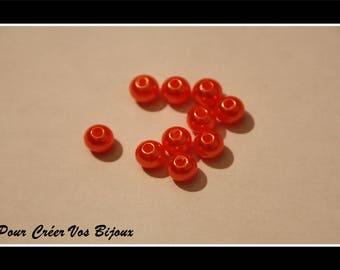 Orange set of 100 plastic round beads 5 mm