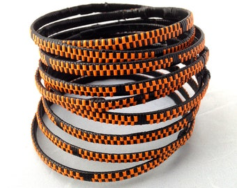Bracelet plastic bracelet, braided ethnic bracelet with recycled wire from electrical wire, set of 10 orange, black African bangles