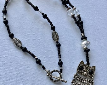 Black beaded necklace with owl pendant