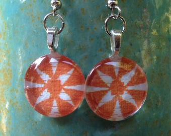 Charming circle glass tile in orange flower. 1/2 inch circle glass tile